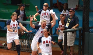 Monica Abbott #14 joins her team to celebrate a 3-run home run in the top of the ninth inning to give USA a 4-0 lead against Japan in the women's semifinal softball event at the Beijing 2008 Olympic Games in 2008.