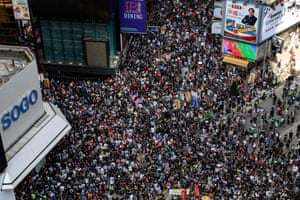 Protesters attend a pro-democracy march in the Causeway Bay district of Hong Kong