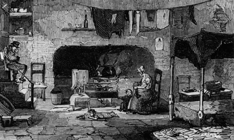 A family living in a cellar near St Giles, London.
