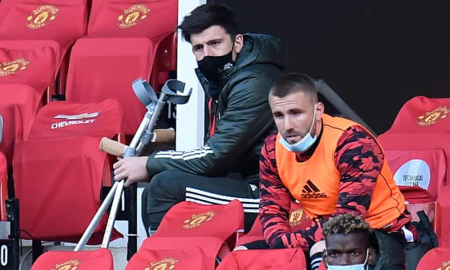 Harry Maguire used crutches and wore a protective boot when he watched Manchester United's game against Leicester.