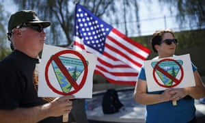 Supporters hold signs during a rally in support of rancher Cliven Bundy.