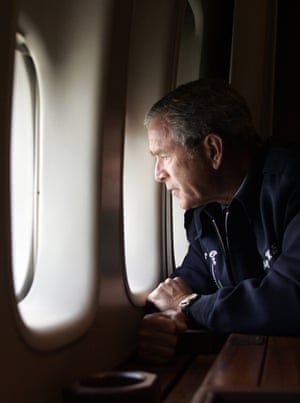 George W. Bush looks out the window of Air Force One as he flies over New Orleans, Louisiana, surveying the damage left by hurricane Katrina in 2005.