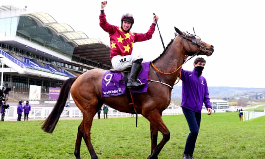 Jack Kennedy celebrates on Minella Indo after winning the Cheltenham Gold Cup in March.