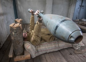 A Ukrainian serviceman exercises with 35 kg weight made from 120mm mortars, in an improvised gym not far of the crisis front line in Vodyane village of Donetsk area, Ukraine, on 16 October