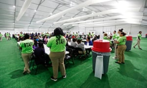 Staff oversee breakfast at the US government's government's newest holding center for migrant children in Carrizo Springs, Texas.