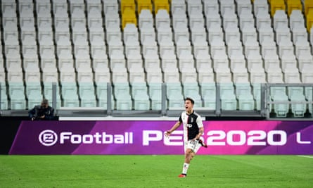 Paulo Dybala celebrates scoring for Juventus against Inter in a game played behind closed doors on 8 March.