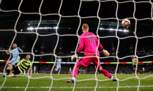 Manchester City's Sergio Agüero scores their fourth goal against Huddersfield on Wednesday.