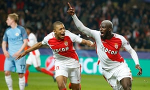 Monaco's Tiemoue Bakayoko, right, celebrates with Kylian Mbappe after scoring their third goal.