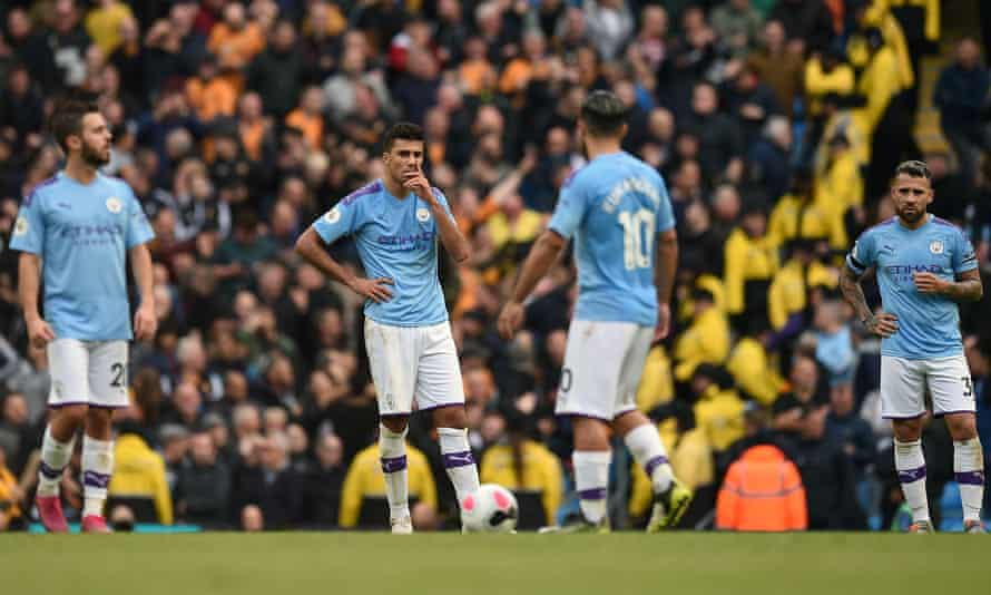 Manchester City players are disconsolate after Wolves' second goal guaranteed their defeat