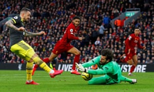 The form of Alisson, saving here from Southampton's Danny Ings, has also been key for Liverpool.