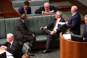 Senator George Brandis talks to Prime Minister Malcolm Turnbull during a division in the House of Representatives this evening, Monday 18th April 2016.