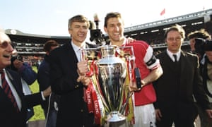 Arsenal manager Arsene Wenger and club captain Tony Adams hold the championship trophy after the FA Carling Premiership match against Everton at Highbury in London.