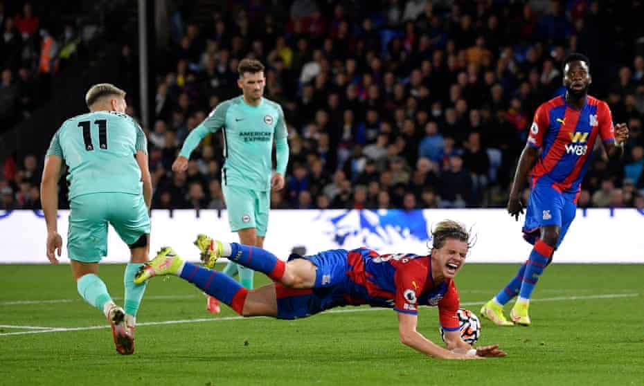 Leandro Trossard (left) is deemed to have fouled Crystal Palace's Conor Gallagher late in the first half.