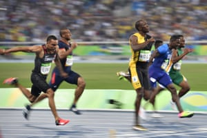 Jamaica's Usain Bolt crosses the finish line ahead of Justin Gatlin to win gold.