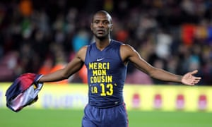 FC Barcelona's defender Eric Abidal, in 2013, wearing a shirt with logo thanking his cousin for the liver donation.