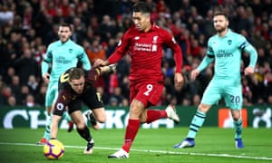 Roberto Firmino scores the first goal of his hat-trick in Liverpool's 5-1 thrashing of Arsenal at Anfield last season.