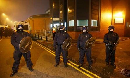 Police officers in riot gear outside Birmingham prison