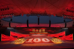 Performers form the number 100 at a gala show in Beijing