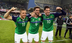 Conor Washington, left, Will Gregg , centre, and Kyle Lafferty celebrate after scoring against Belarus in a friendly before Euro 2016.