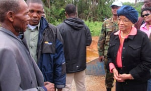 Ellen Johnson Sirleaf speaks to locals about Ebola outside the Liberian town of Ganta in October 2014