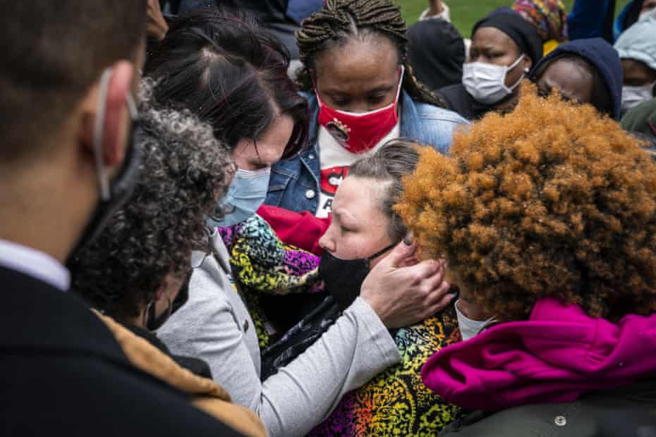 Katie Wright, center right, the mother of Daunte Wright, is embraced by George Floyd's girlfriend, Courteney Ross, center left, in Minneapolis on 13 April.