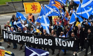 Thousands of pro-Scottish independence campaigners carry the Saltire as they march through the streets of Glasgow on 5 May.