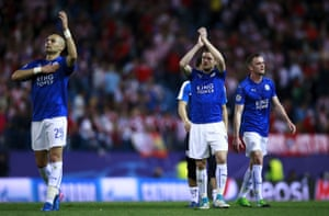 Leicester's Yohan Benalouane, left, and Jamie Vardy, second right, acknowledge their fans after the final whistle.