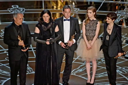 The Citizenfour team accept the award for best documentary feature.