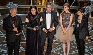 Laura Poitras, second left, accepts her award for Citizenfour.