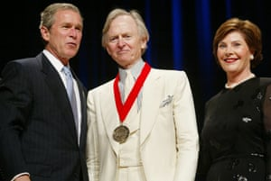 Tom Wolfe receives a National Endowment for the Arts National medal from President George W Bush and the first lady, Laura Bush, in April 2002