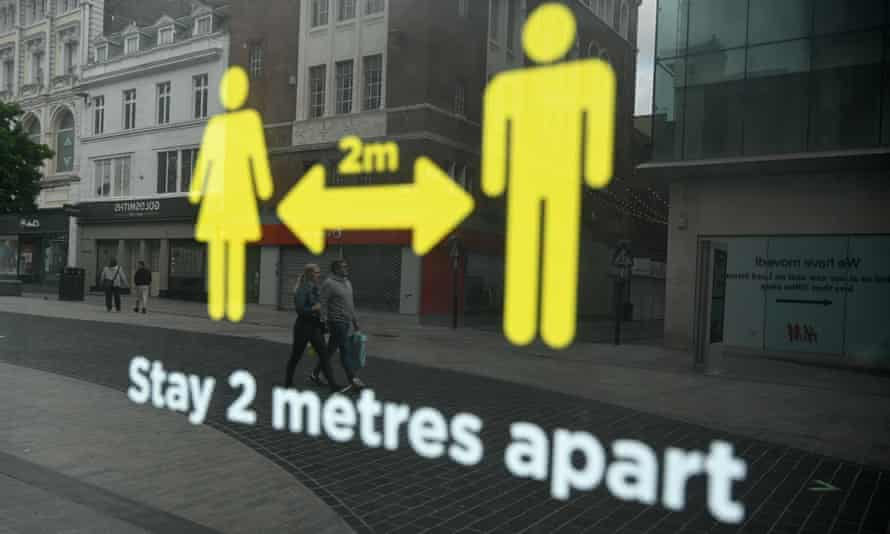 A window sticker on a shop in Liverpool advises people to abide by physical distancing