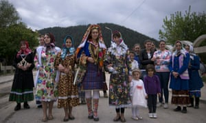 A Pomak bride is escorted during her three-day wedding ceremony in the village of Draginovo, Bulgaria.
