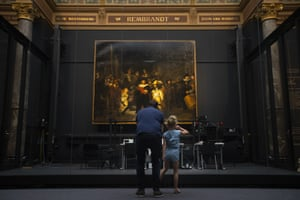 Visitors take in The Night Watch at the Rijksmuseum in Amsterdam in June.