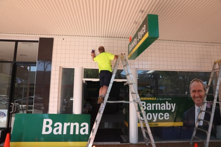 Workers erect signage outside the campaign headquarters for Barnaby Joyce in Tamworth