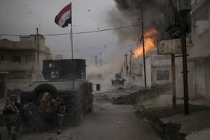 Spot news – singles, third prize  A car bomb explodes next to Iraqi special forces vehicles as they advance towards Islamic State-held territory in Mosul