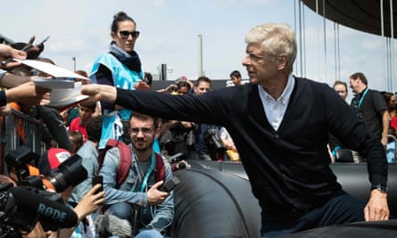 Arsène Wenger signs autographs for fans in Paris this week.