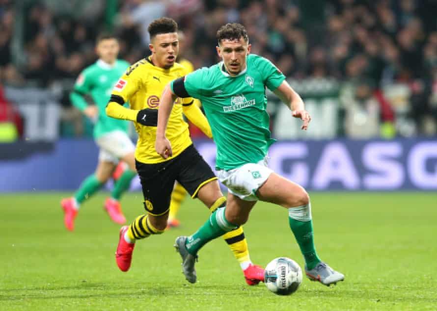 Werder Bremen's Milos Veljkovic surges past Jadon Sancho of Borussia Dortmund at the Weserstadion in February 2020.