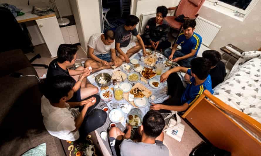 The Afghan refugees have dinner together