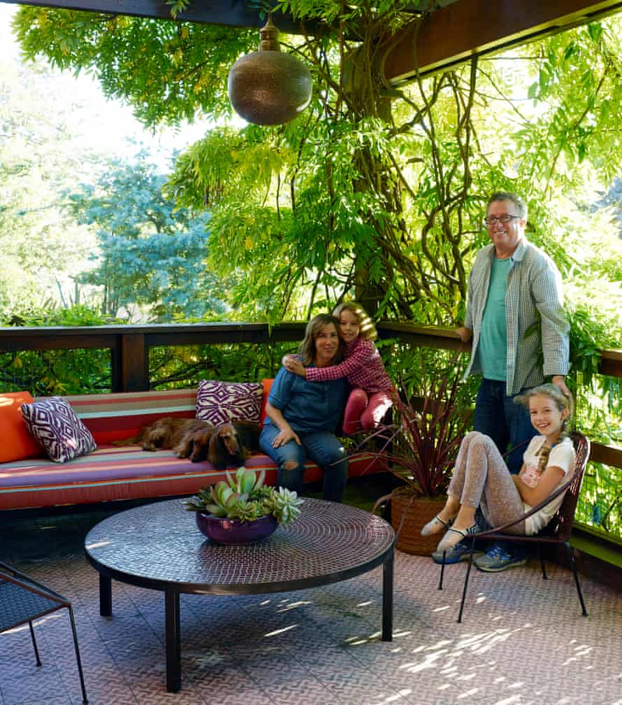 Among the trees: the terrace where the family often spend time together.