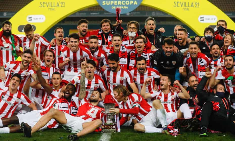 Athletic Bilbao players celebrate with the trophy after beating Barcelona 3-2 in extra time.