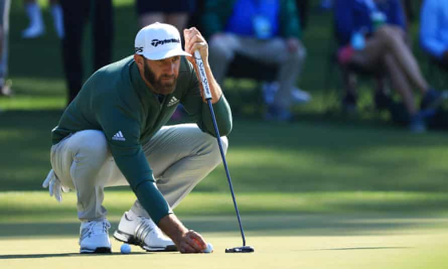 The world No 1, Dustin Johnson, lines up a putt during a practice round at Augusta on Monday.