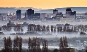 Smog and smoke from wood and coal fires at dawn in Christchurch, New Zealand.