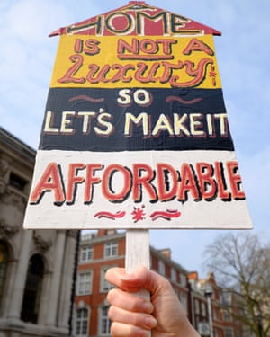 A placard reading 'Home is not a Luxury so let's make it affordable'.