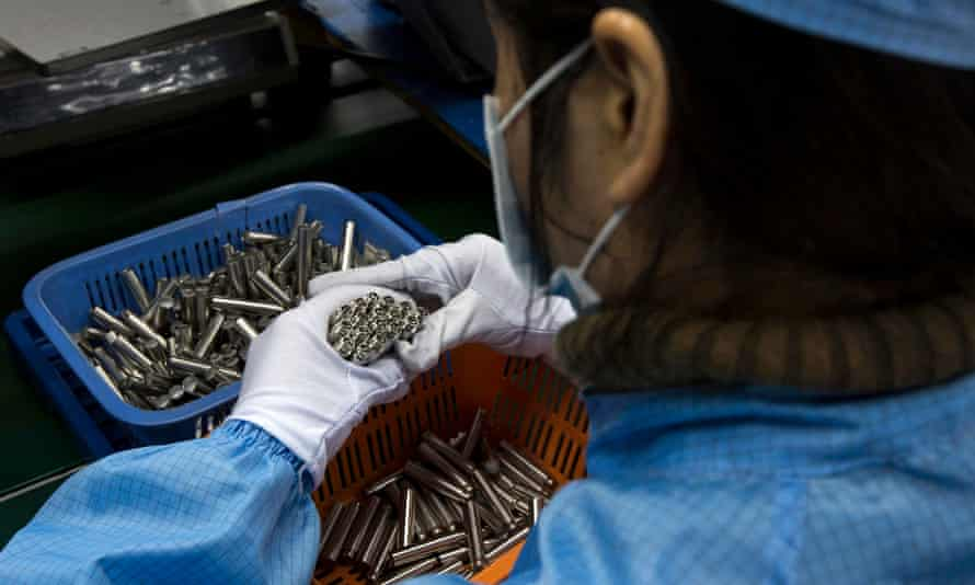 An employee checks e-cigarettes at a factory in Shenzhen, in the southern Chinese province of Guangdong.