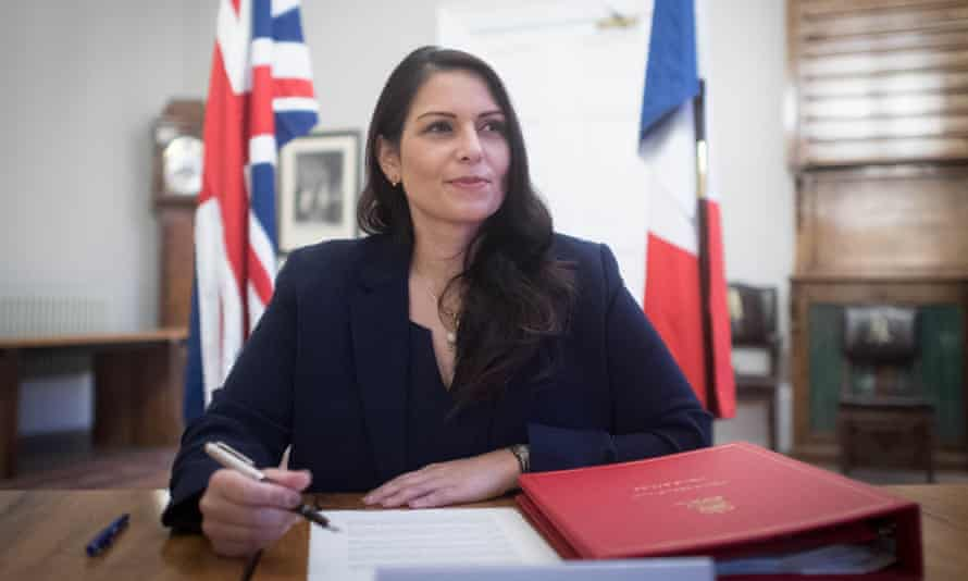 The home secretary Priti Patel signs the new agreement with her French counterpart Gerald Darmanin aimed at curbing the number of migrants crossing the Channel in small boats.