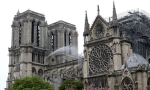 Firefighters work at Notre Dame Cathedral after a massive fire devastated large parts of the Gothic church in Paris.
