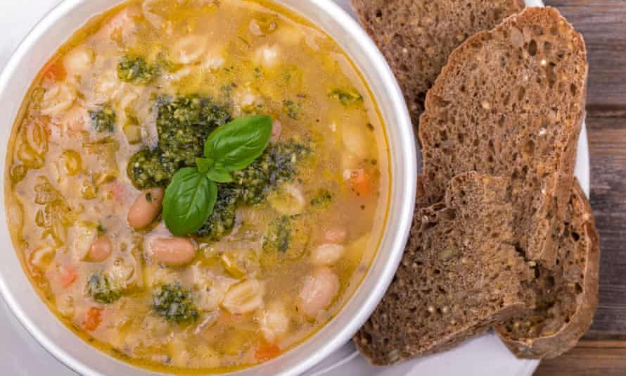 A bowl of minestrone soup with wholegrain bread