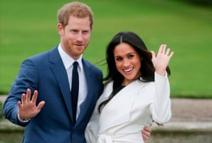 Prince Harry and Meghan Markle pose for a photograph following the announcement of their engagement