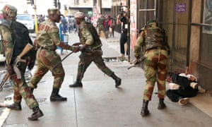Soldiers beat a protester outside the Movement for Democratic Change party headquarters in Harare.