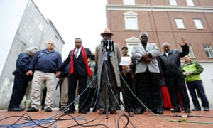 The Rev Nelson B Rivers II holds a prayer vigil in front of the Charleston courthouse as the jury deliberates on Monday in Charleston, South Carolina.